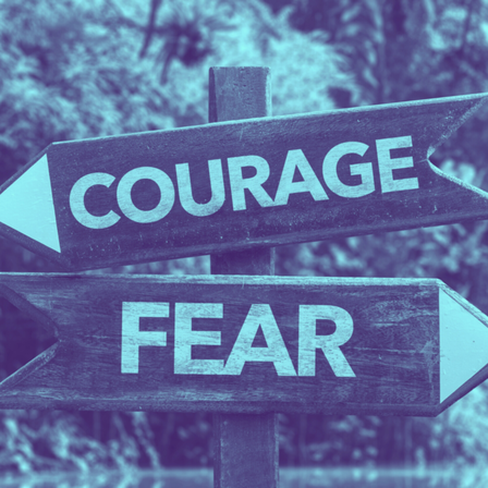 A sign with the words courage and fear
